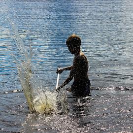Boy splashing  by Jarmo Ainasoja - People Family ( water, splash, summer, lake, boy )