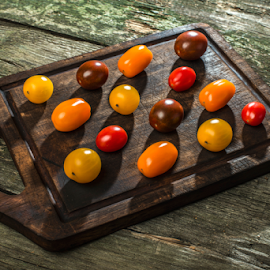 Variety of cherry tomatoes on wood by Deyan Georgiev - Food & Drink Fruits & Vegetables ( different, raw, juicy, diet, tomato, bright, colorful, yellow, autumn, fresh, ingredient, vegetarian, orange, isolated, green, white, vegetables, agriculture, tomatoes, variety, cherry, organic, red, market, food, background, ripe, summer, healthy, harvest, vegetable )