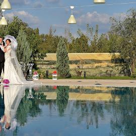 Wedding Day by Sorin Lazar Photography - Wedding Bride & Groom ( water, clouds, reflection, arrangement, married, sky, nature, colors, wedding, umbrella, bride, groom )