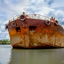An ore carrier by Sergey Sibirtsev - Transportation Boats ( reflection, old, expansive sky, expansive, goa, ore carrier, ore, blue water, rusty, sky, ancient, blue, carrier, india, mandovi, rust, river,  )