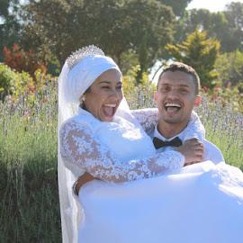 Happy by Justin Kumlehn - Wedding Bride & Groom ( laughing, bride, garden, groom, smiling )