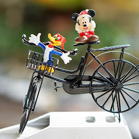 Sharing a ride by Alice Chia - Artistic Objects Toys ( mickey mouse, basket, black, bicycle, woody woodpecker )