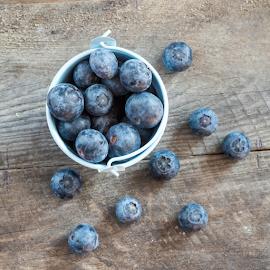 Blueberries by Robert  Płóciennik - Food & Drink Fruits & Vegetables ( raw, nobody, old, juicy, blueberry, seasonal, wood, diet, ceramic, rustic, heap, berry, bilberry, vegetarian, closeup, gourmet, dessert, top, bowl, vintage, white, delicious, table, health, gray, blueberrie, many, organic, nutrition, sweet, porcelain, horizontal, food, background, ripe, healthy, summer, view, vitamin, group, natural,  )