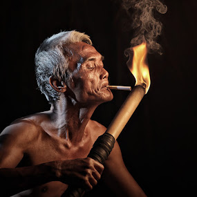 How Do You Light Yours? by Lucky E. Santoso - People Portraits of Men