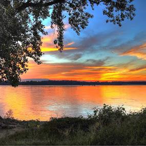 Fiery sky above the Mississippi River by Joe Machuta - Landscapes Sunsets & Sunrises