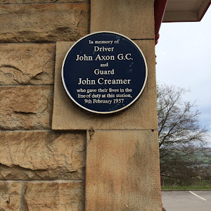This plaque at Chapel-en-le-Frith railway station commemorates the brave actions of a train driver (John Axon) and guard (John Creamer), who died while trying to stop a runaway freight train on a 1 ...