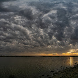 Crumbling by Clive Wright - Landscapes Cloud Formations ( orange, estuary, sunset, clouds, water )