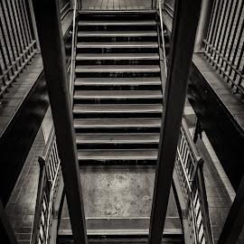 Steps Down by Dutch Bagley - Black & White Abstract ( subway, garage, rail, train, tracks, steps, underground, steel )