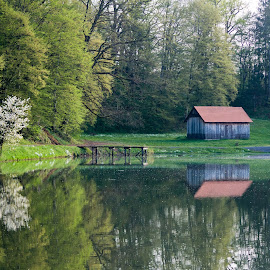 By the Lake in Topusko, Croatia by Ferdo Fulgosi - Landscapes Waterscapes ( peer, reflection, hut, lake, house, woods )