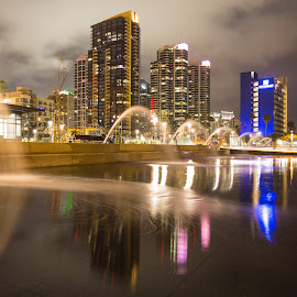Water Park Reflections by Christopher Payne - City,  Street & Park  Skylines ( water, san diego, diego, reflection, san, park, fountains, fountain, reflections, night, front, waterfront, downtown )