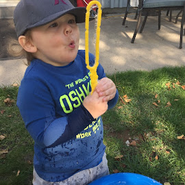 Blowing Bubbles  by Debbie Squier-Bernst - Babies & Children Children Candids