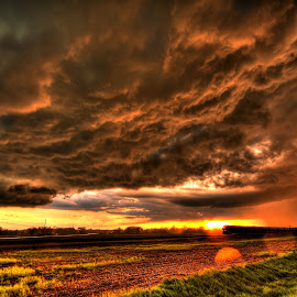 running from the Rain by Derrill Grabenstein - Landscapes Sunsets & Sunrises