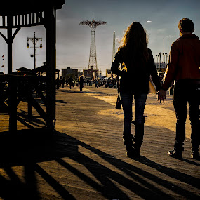 Coney Island Lovers by Fran Gallogly - City,  Street & Park  Amusement Parks ( parachute jump, lovers, amusement park, sunset, couple, new york city, coney island, boardwalk, shadows, brooklyn )