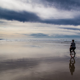 On the Beach by Mats Nordgren - Sports & Fitness Cycling ( water, unicycling, sunset, ocean, beach )