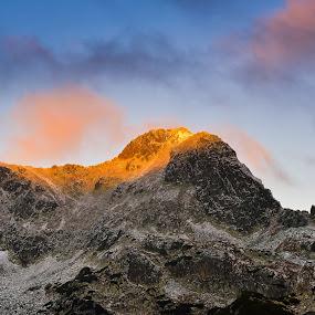 Light's first kiss by Lucian Satmarean - Landscapes Mountains & Hills ( mountain, cold, blue, snow, rock, sunrise, light )