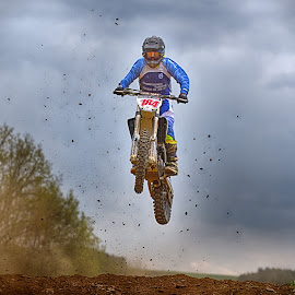 Trough The Clumps Hail by Marco Bertamé - Sports & Fitness Motorsports ( hail, clouds, speed, fying, number, race, noise, jump, red, motocross, blue, 184, dust, clumps, air, high )