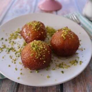 Cardamom Bollas With Saffron Syrup