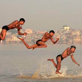 Jump by Debajit Bose - Babies & Children Children Candids ( child, ganga, varanasi, morning, swimming, jump )