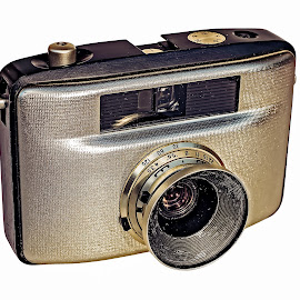 Retro photo camera by Opreanu Roberto Sorin - Artistic Objects Antiques ( optical, body, old, technology, retro, equipment, analog, object, photography, style, metal, glass, focus, nostalgia, classic, black, top, film, isolated, vintage, silver, art, camera, white, professional, photo, lens, close-up, aperture, shutter, background, view, antique )