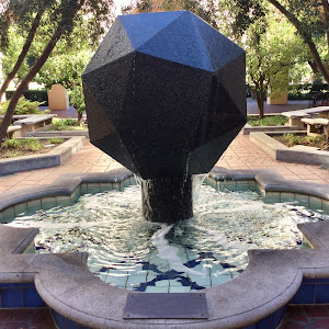 The polyhedron in the fountain is a snub cube, an Archimedean semi-regular solid derived from a cube, with all its edges of equal length. This shape was chosen for the central fountain in the Beckman ...