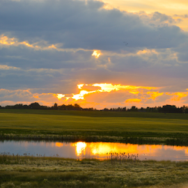 As the Sunday Goes Down by Sylvia Meier - Landscapes Prairies, Meadows & Fields ( nature, waterscape, pond color, reflections, pond )