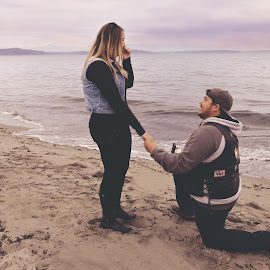 Will You Marry Me? by Lindsey Sides - People Couples ( love, shore, mountains, commitment, happy, proposal, shoreline, candid, couple, she said yes, beach, engagement )
