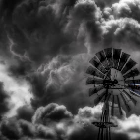 Aeromotor by Roch Hart - Products & Objects Industrial Objects ( clouds, ranch, old, bw, rural, farm, aeromotor, ranching, new mexico, black and white, farms, windmill, roch hart )