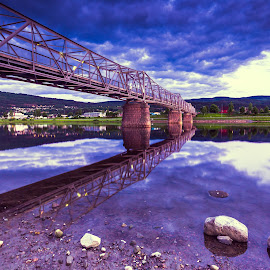Bridge by Geir Blom - Landscapes Cloud Formations ( water, reflection, bridge, stones, river )