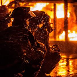 Fighting fire by Arisha Singh - People Portraits of Men ( firefighter, flames, fireman, emergency, rescue, fire, ems )