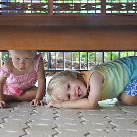 Under The Table by Geoffrey Wols - Babies & Children Children Candids ( girl, hiding, children, table, fun, kids, smile, boy,  )
