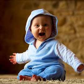 Baby in Blue by Darren Reynolds - Babies & Children Babies ( hand, rug, sitting, laugh, blue sweater, blue, stone, arms, baby, smile, boy )