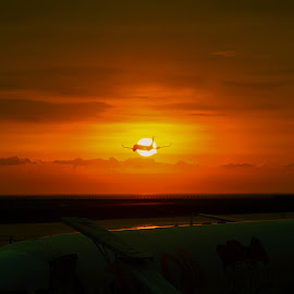 Landed at sunset by Iman Supratikno - Landscapes Sunsets & Sunrises ( airport, landing, airplane, sunset, transportation, ngurah rai international airport )