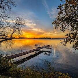 Fall Sunset by Mike Karels - Landscapes Sunsets & Sunrises ( water, orange, estherville, blue, sunset, trees, ingham lake, dock )
