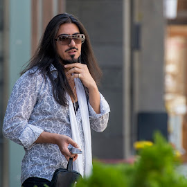waiting for a call by Lucian Pirvu - People Street & Candids ( white, brown, long, hair, man, shirt,  )