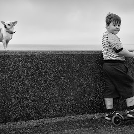 Daisy & Dash by Dan Horton-Szar ARPS - Babies & Children Children Candids ( child, reculver, monochrome, black and white, pet, kent, chihuahua, dog, boy, scooter )
