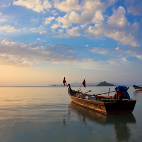 The Boat II by Tsukiyama Kaminaga - Landscapes Waterscapes ( water, clouds, orange, sea, malaysia, beach, seascape, boat, island, blue sky, serenity, sunset, langkawi, tranquility )
