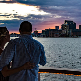 Couple enjoys sunset cruise by Jackie Nix - People Street & Candids ( inner harbor, skyline, harbor, ship, baltimore, people, cruise, attraction, tourists, american, woman, buildings, maryland, couple, pink, man, banner, clouds, water, purple, tourism, postcard, boat, dusk, urban, flag, bay, sunset, sundown, tour, river )