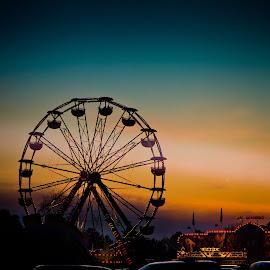 The Ferris Sunset by Peggy Zinn - City,  Street & Park  Amusement Parks ( trout festival, sunset, fair  rides, festival, ferris wheel,  )