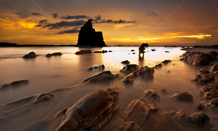 Sunset behind the Rock by Gerry Setiawan - Landscapes Travel
