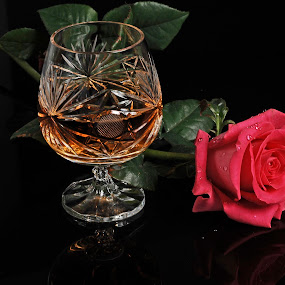 Cognac and Pink Rose by Cristobal Garciaferro Rubio - Food & Drink Alcohol & Drinks ( flwoers, cups, reflection cup, cognac, pink rose, leaves, brandy, flower )