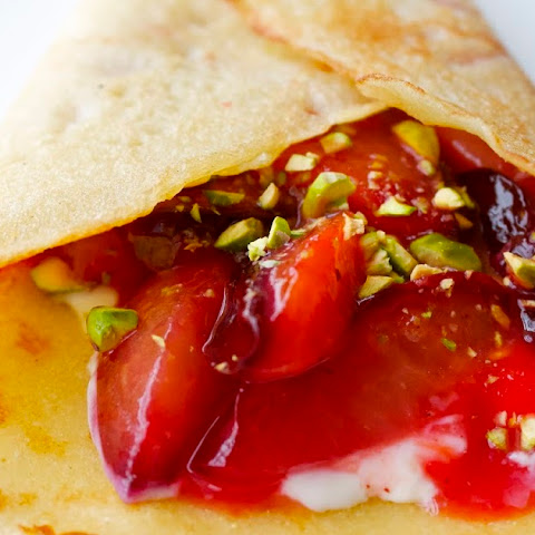 Honey Crepes with Black Plums, Mascarpone, and Pistachios