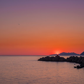 by Miho Kulušić - Landscapes Waterscapes ( orange, red, waterscape, sunset, lighthouse, rocks,  )