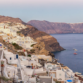 Hill Climbing by Dan Herman - City,  Street & Park  Neighborhoods ( hill climbing, sunset, greece, oia, santorini )