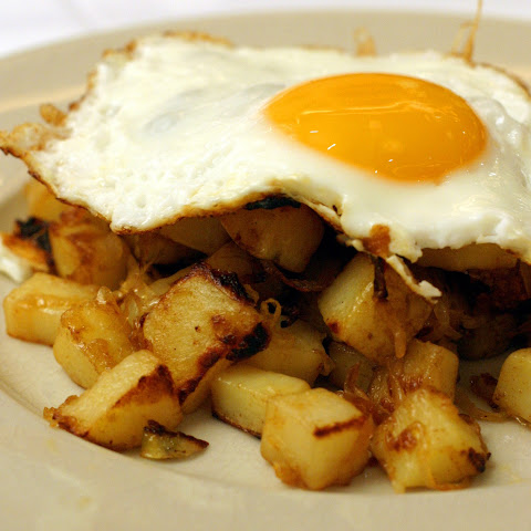 Potato And Onion Hash With A Fried Egg