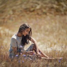 Girl sitting in the field by Andrius Mačiūnas - People Portraits of Women ( portrait woman sitting grass field sand dune nida, girl )