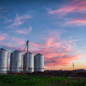 Gilbert Silos by Scott Wood - Landscapes Sunsets & Sunrises ( clouds, field, gilbert, structure, desert, sky, color, sunset, arizona, agriculture, travel, evening, sun )