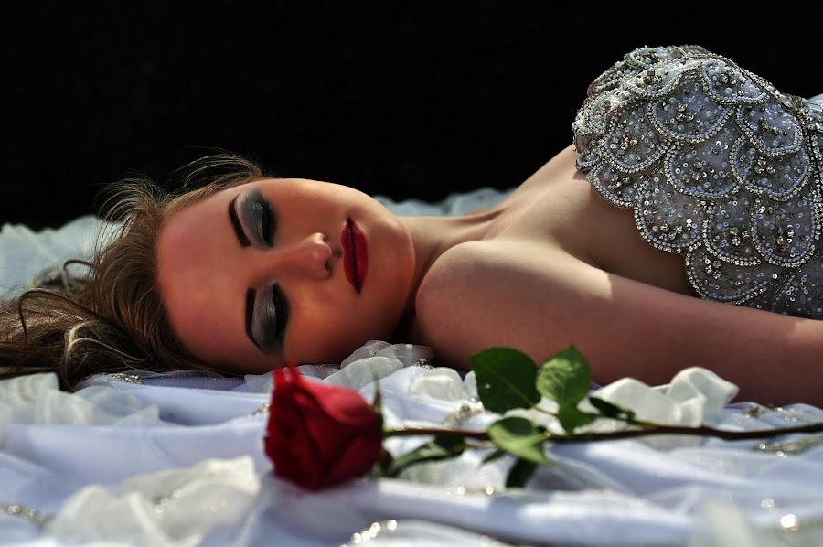 the bride and a rose by Don Eugene Roces - Wedding Bride