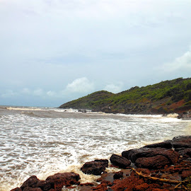 Rock covered Anjuna beach in Goa. by Sambit Bandyopadhyay - Nature Up Close Rock & Stone ( sea, beach, rocks )