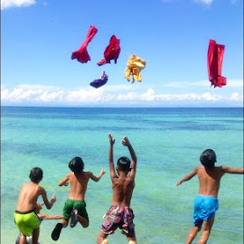 Colorful Sky! by Dickson   Shia - Babies & Children Children Candids ( cliff, action, dive, beach, kids )