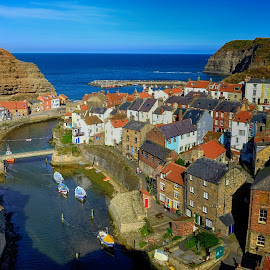 Staithes by Graham Sivills Fimis - City,  Street & Park  Vistas ( fishing boats, coast, england, blue, yorkshire, red tiles, red rooves, red roof, boats, village, sea, stream fishing village,  )